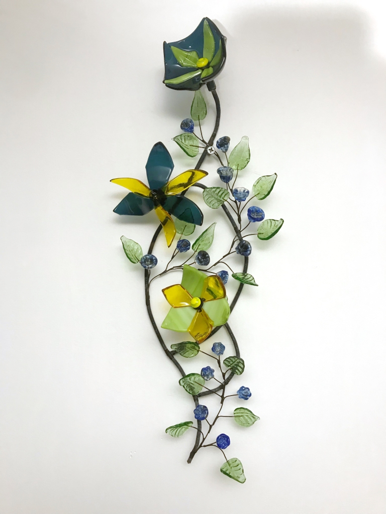 yellow blue and green glass flowers